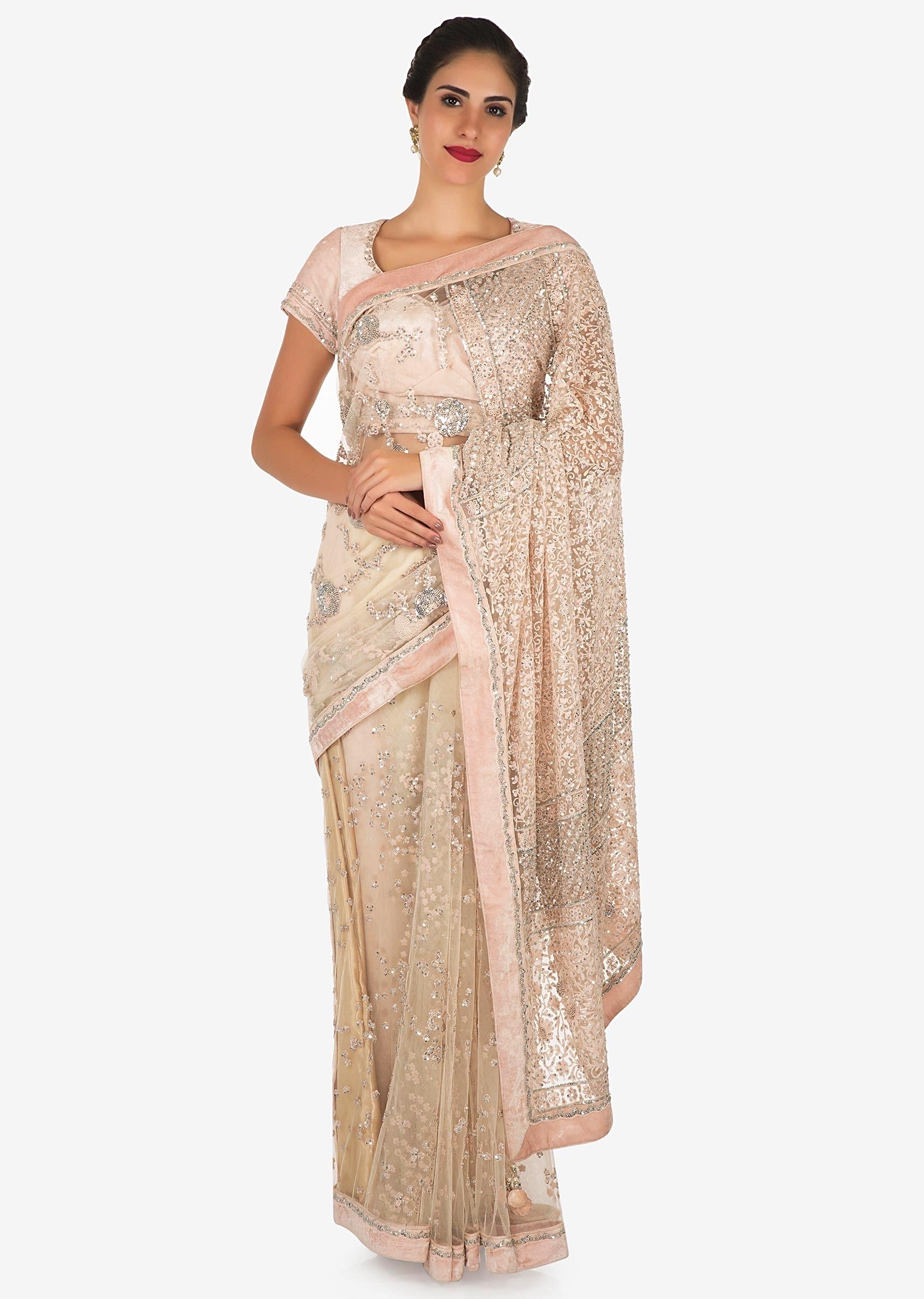 Pastel Hued Saree In Net With Velvet Blouse Adorn In Heavy Sequin And Thread Embroidered Work Only On Kalki