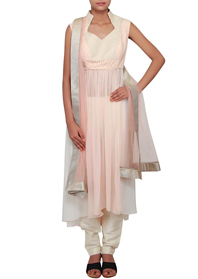 Peach and off-white ombre anarkali featured in georgette with weave and thread work only on Kalki