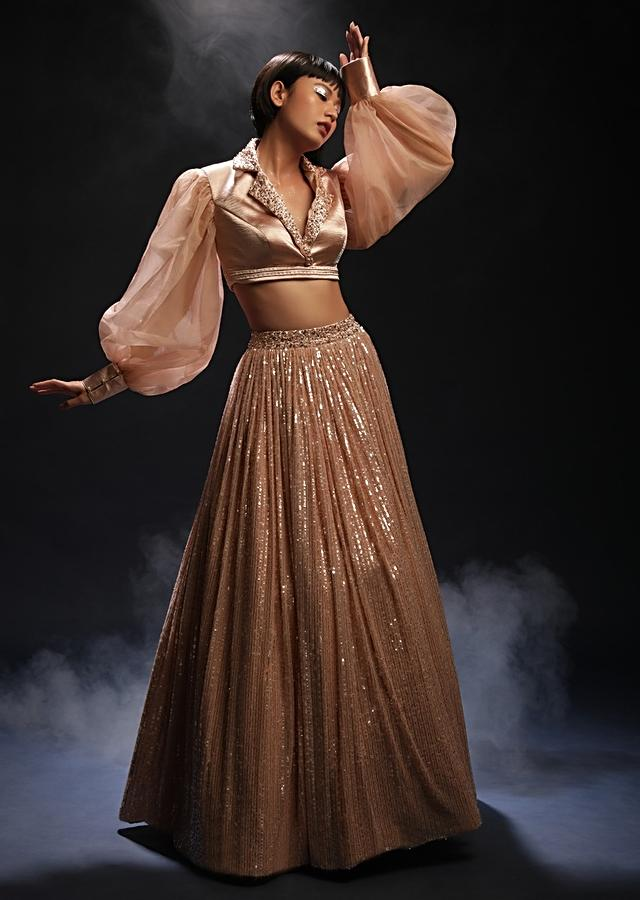 Peach Champagne Lehenga In Sequins Fabric And Velvet Crop Top Designed With Balloon Sleeves And Collar Neckline Online - Kalki Fashion
