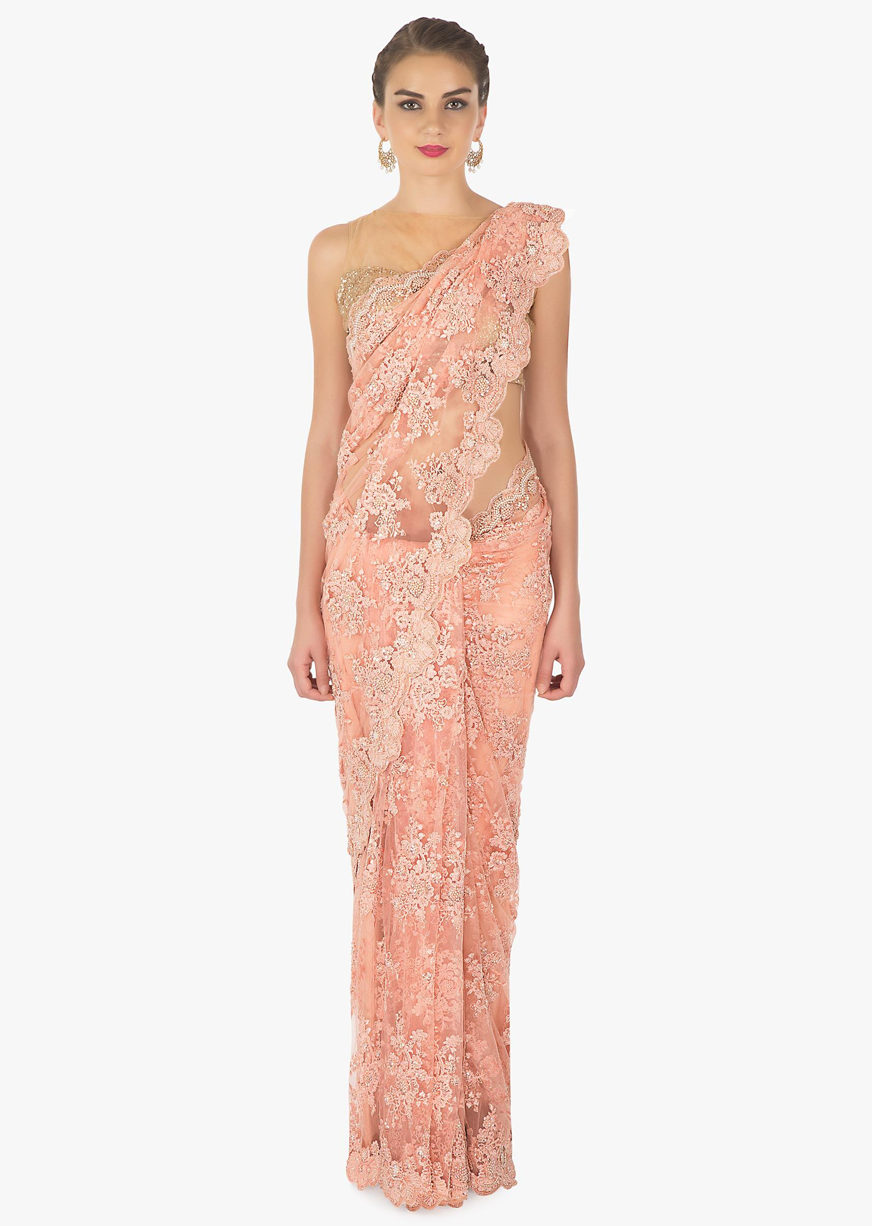 4e1db3fcb0164 Peach embroidered net saree in sequin and moti only on kalki