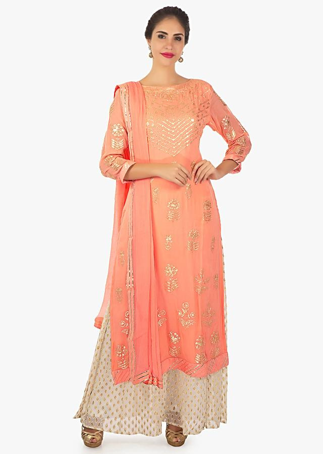 Peach Kurti With Paired With Off White Palazzo And A Chiffon Dupatta Online - Kalki Fashion