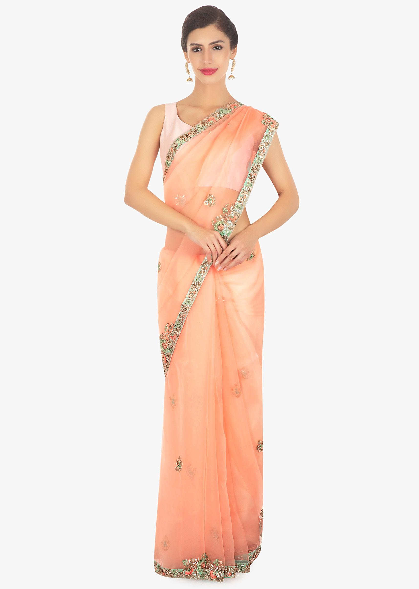 52070db26f Peach organza saree in embroidered butti and border only on KalkiMore Detail