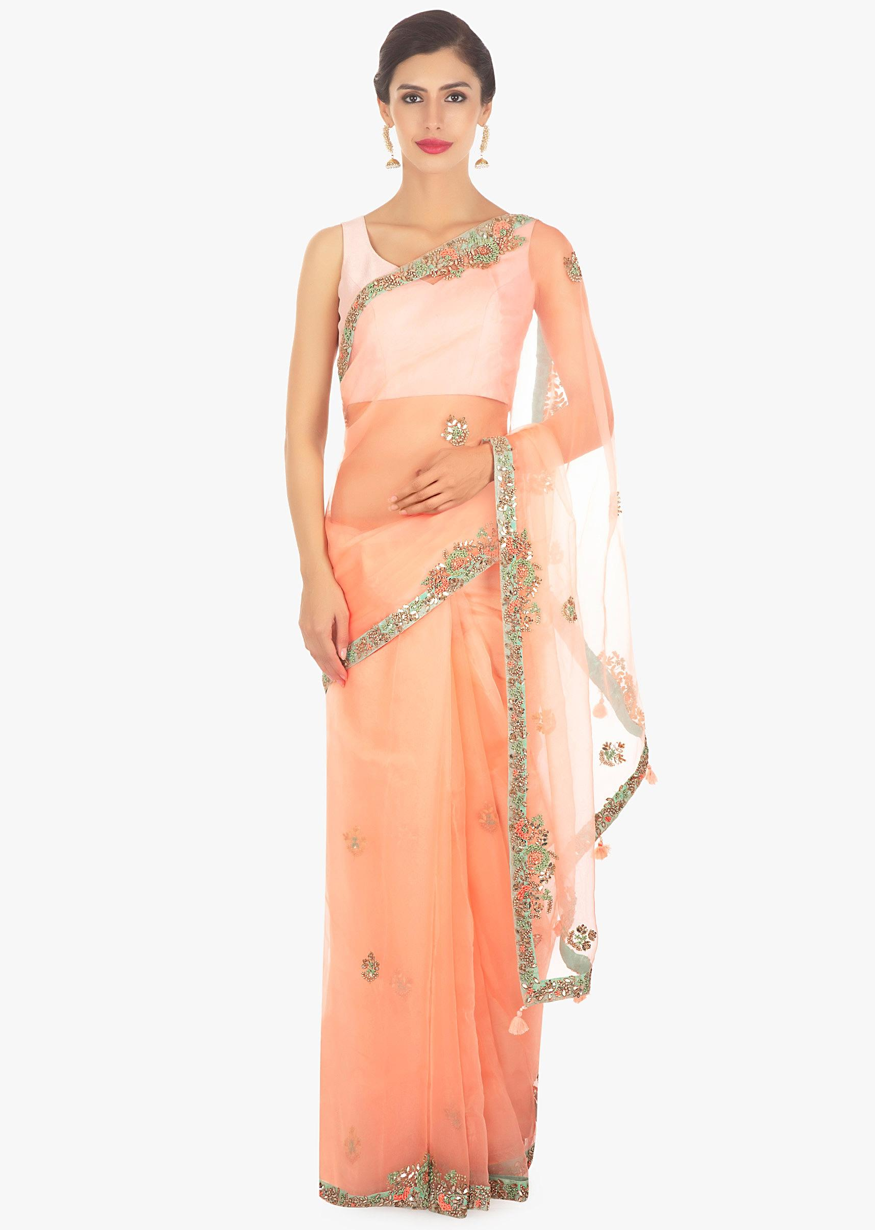 6f93047bc7 Peach organza saree in embroidered butti and border only on Kalki