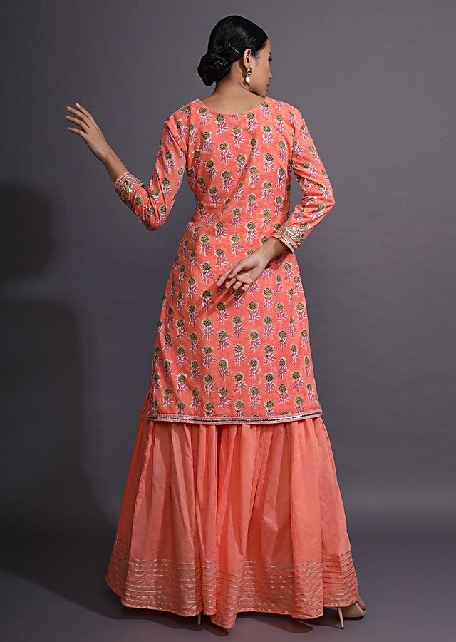 Peach Pink Sharara Suit With Floral Printed Buttis And Gotta Patti Embroidery Online - Kalki Fashion