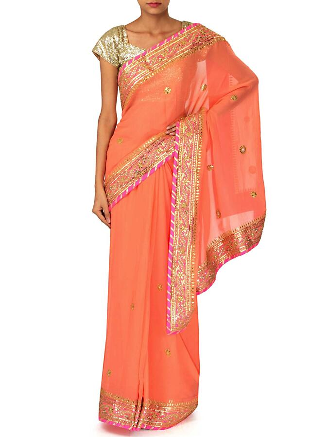 Peach saree adorn in gotta patch embroidered border only on Kalki