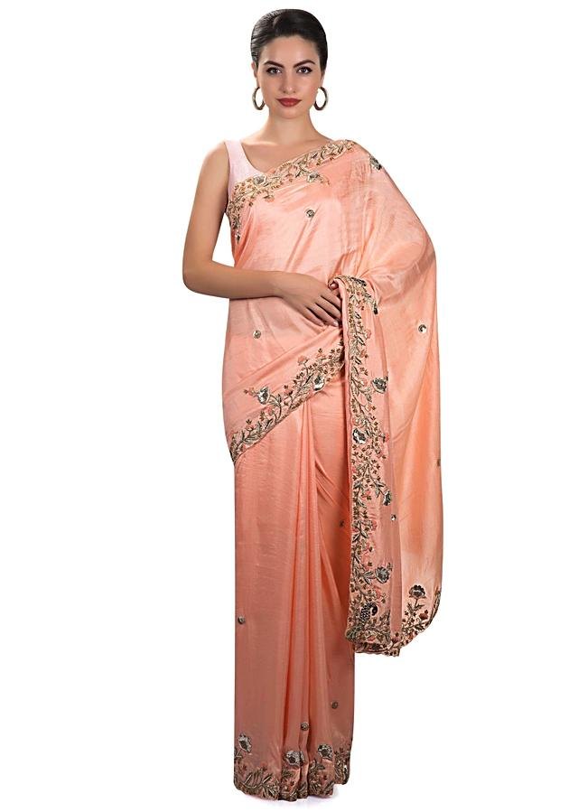 Peach satin chiffon saree with floral motif embellished with zari and sequins only on Kalki
