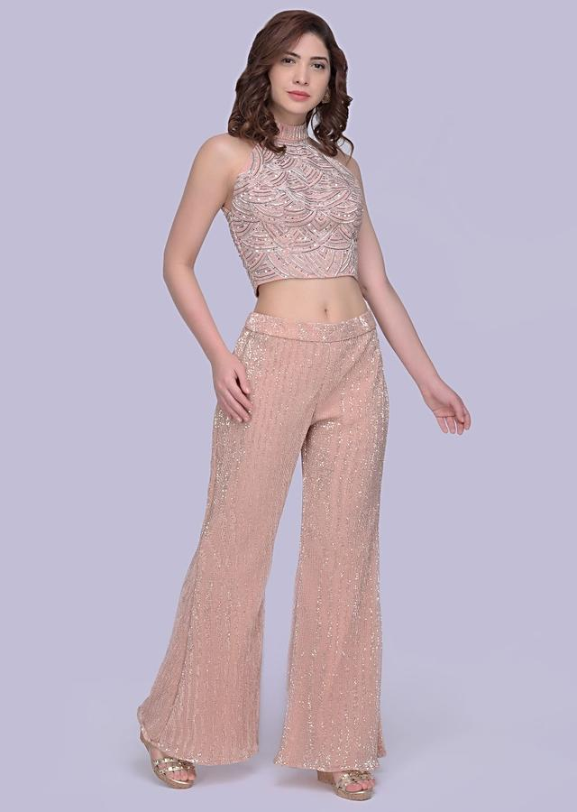 Peach Straight Pant In Sequin Fabric With A Halter Neck Embroidered Crop Top Online - Kalki Fashion
