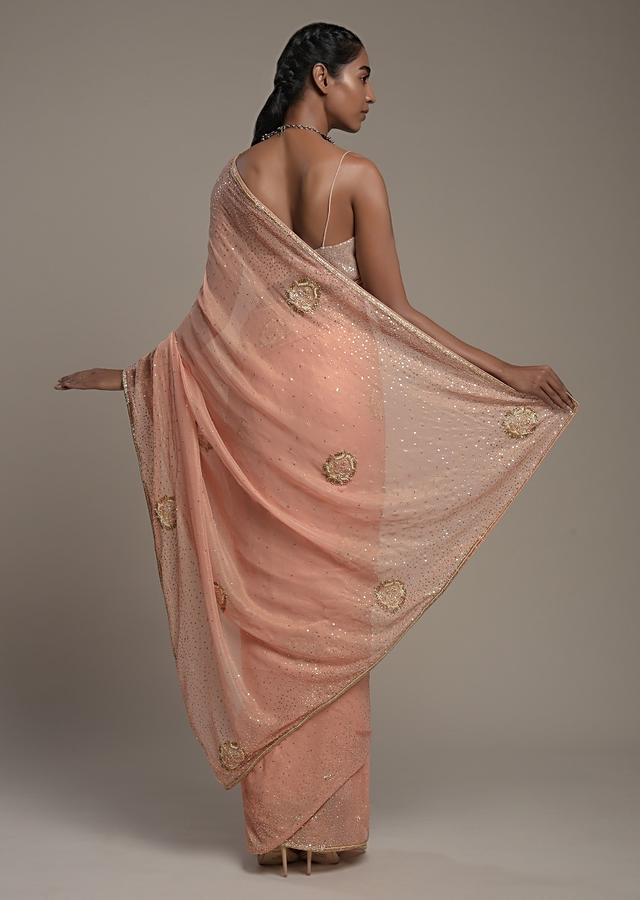 Peach Georgette Saree With Scattered Sequins And Moti Motifs Along With Unstitched Blouse Online - Kalki Fashion
