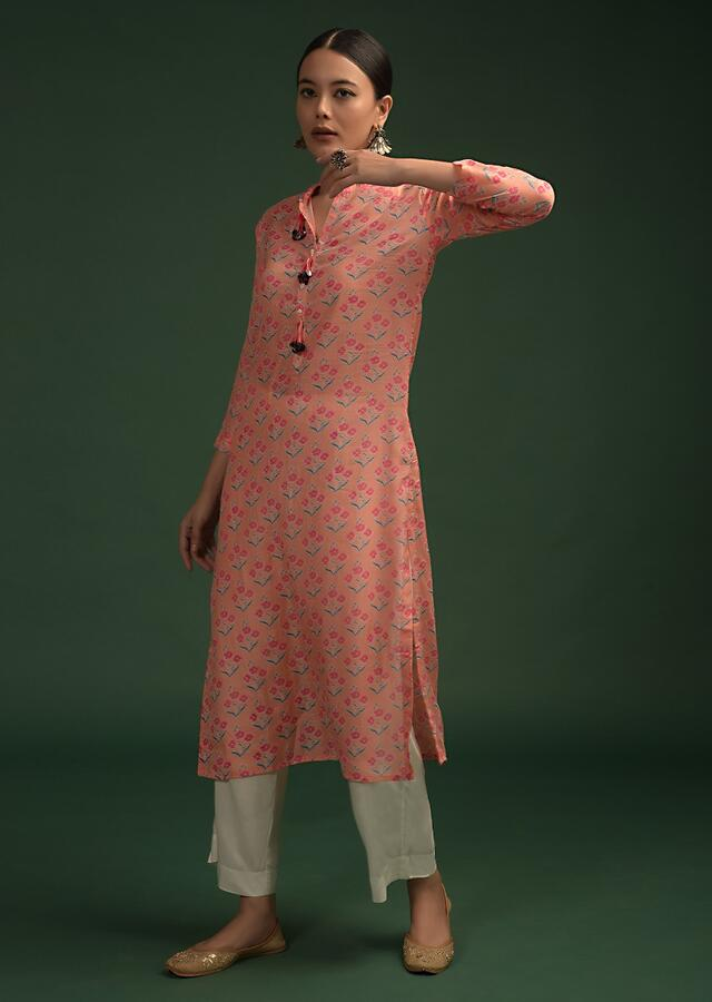 Peach Straight Cut Kurti In Cotton With Printed Floral Buttis And Tassels On The Placket Online - Kalki Fashion