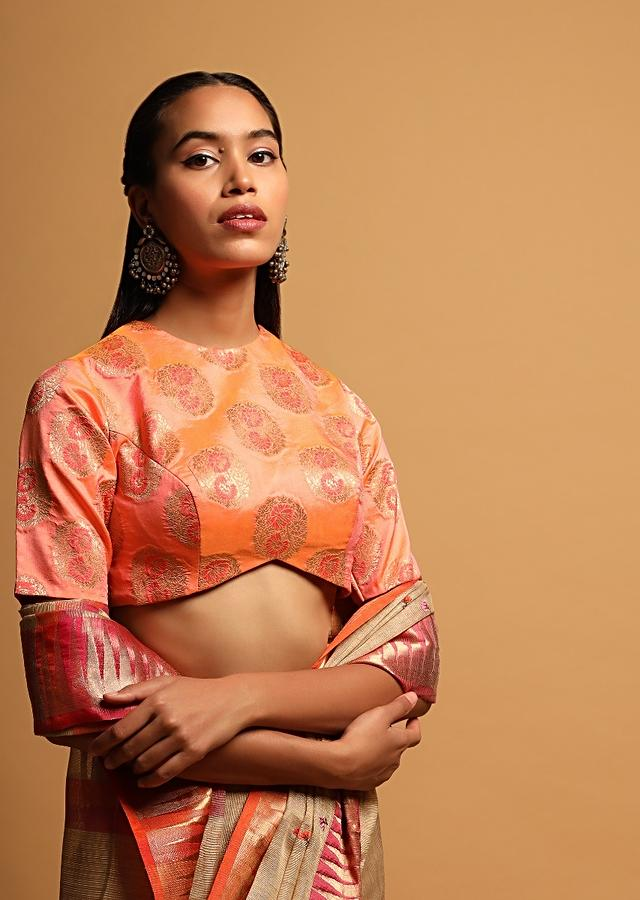 Peach Two Toned Blouse In Brocade Silk With Woven Floral Buttis And Curved Hemline Online - Kalki Fashion