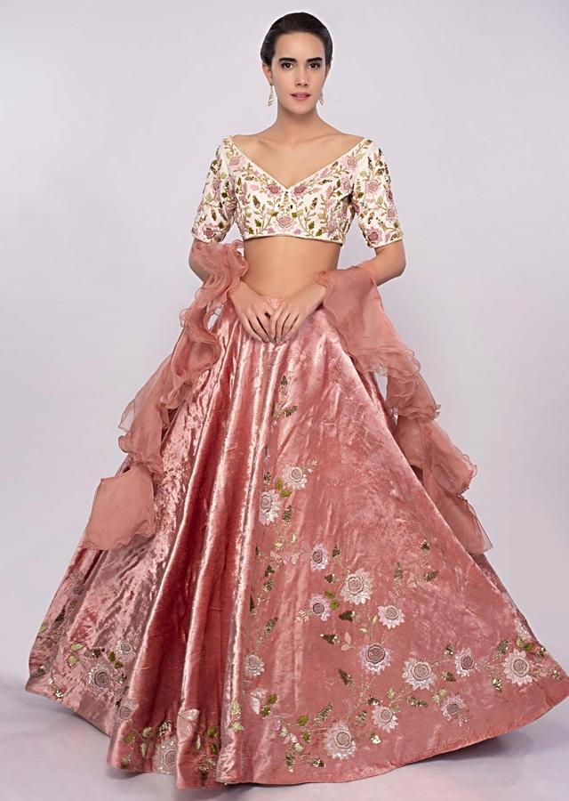 Peach Lehenga In Hand Embroidered Velvet With Cream Embroidered Blouse And Peach Organza Ruffled Dupatta Online - Kalki Fashion
