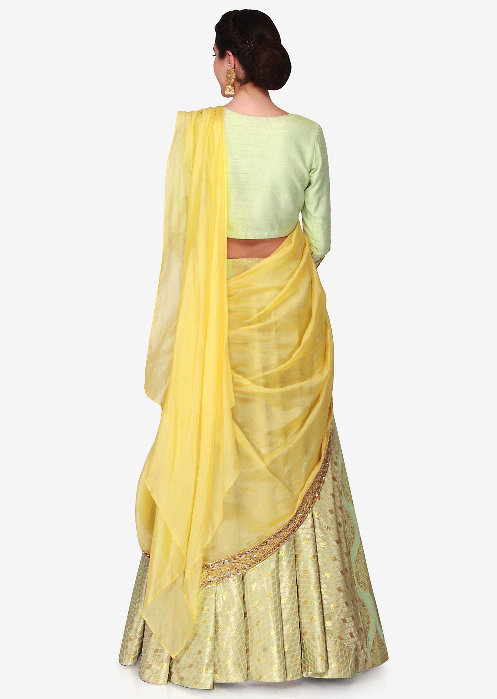 7465f59212 Light green brocade lehenga with a ready styled dupatta in yellow only on  Kalki