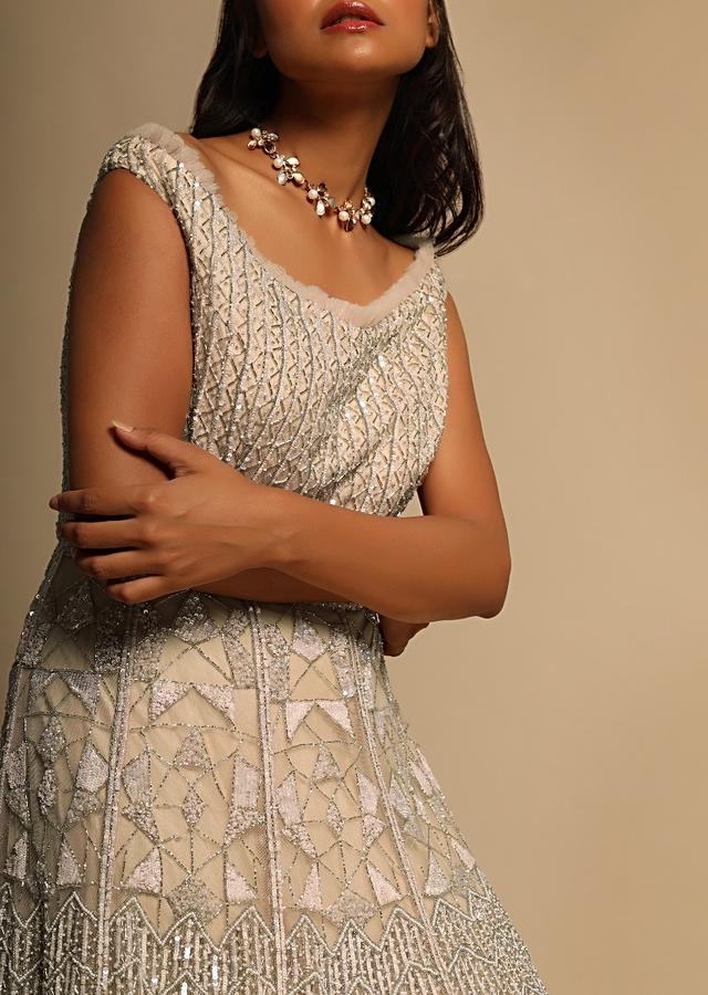 Peachy Beige Gown In Net Embellished With Sequins, Cut Dana And Beads Embroidery In Geometric Motifs Online - Kalki Fashion