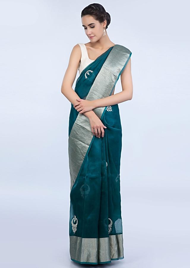 Peacock blue organza saree adorn with abstract butti all over only on Kalki
