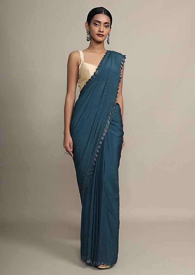 Peacock Blue Saree In Satin Chiffon With Kundan And Cut Dana Border Online - Kalki Fashion