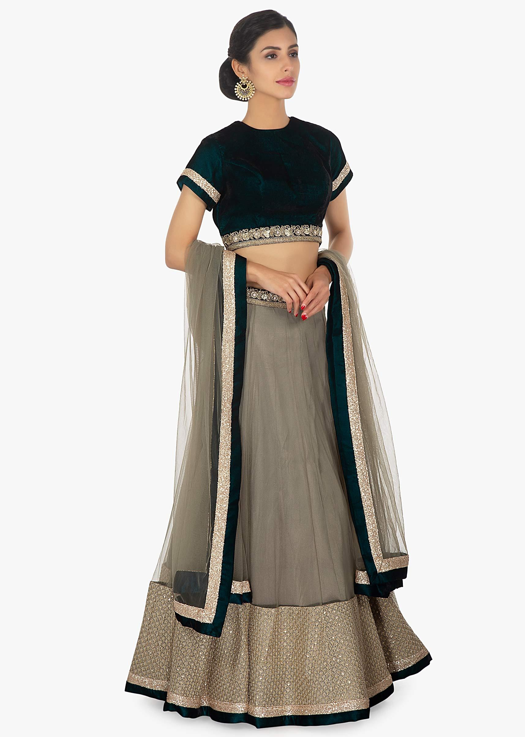 4877e6eb8eeac8 Peacock blue velvet blouse paired with a net satin grey lehenga only on  Kalki
