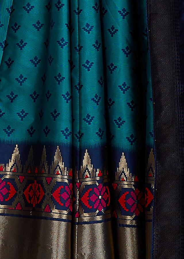 Peacock Green Anarkali Suit With Weaved Buttis And Patola Motifs On The Hem Online - Kalki Fashion