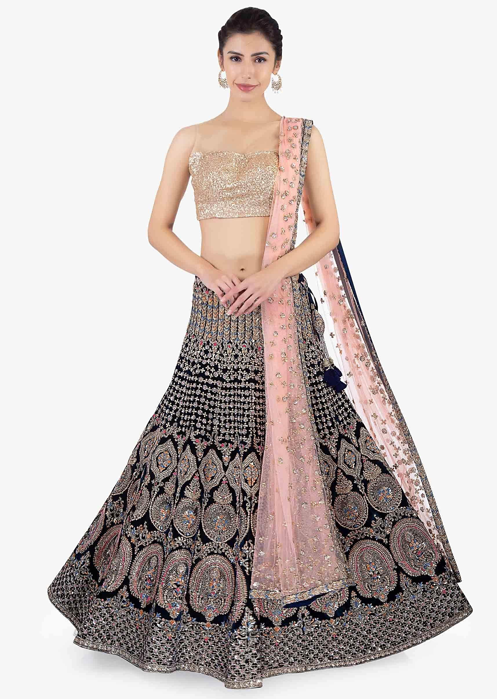 ed18ce0981050 Peacock green heavily embellished lehenga set paired with a pink net  dupatta only on KalkiMore Detail