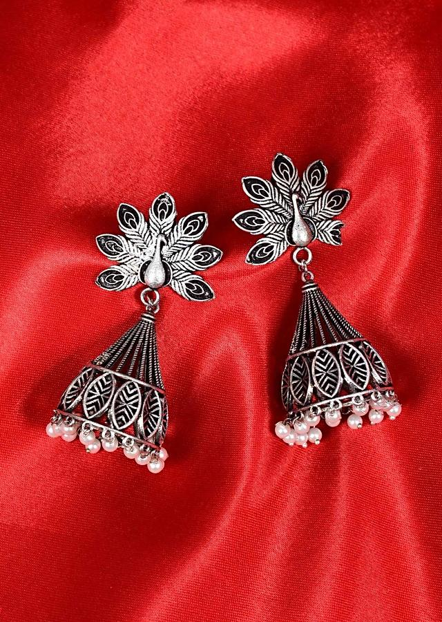 Peacock motif cut out oxidized jhumkas with white moti drops only on Kalki