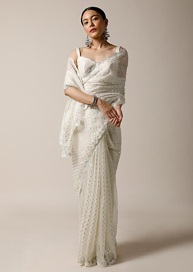 Pearl White Saree In Organza With Foil Printed Buttis And Mirror Work On The Border Along With Unstitched Blouse Online - Kalki Fashion
