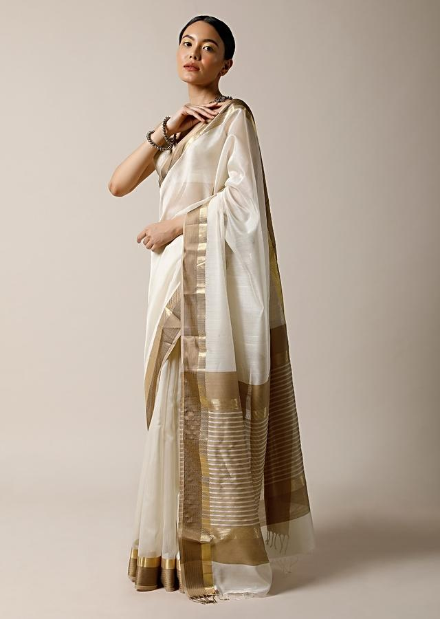Pearl White Saree In Cotton Silk With Woven Golden Border And Contrasting Unstitched Blouse Online - Kalki Fashion