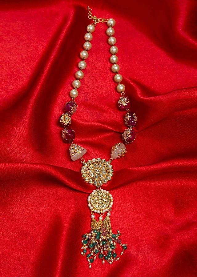 Pearls and plum stone studded long traditional necklace with polki kundan pendant only on Kalki