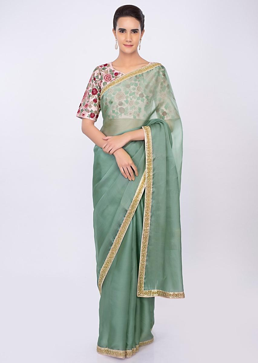 65a8792a1e007 Persian green organza saree with pink floral embroidered blouse only on kalkiMore  Detail