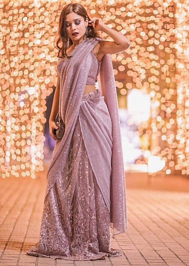 Riya Jain in Kalki dusty pink saree lehenga with draped pallo