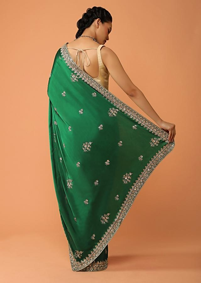 Pine Green Saree In Satin With Sequins And Zardosi Embroidered Floral Border And Butti Design Online - Kalki Fashion