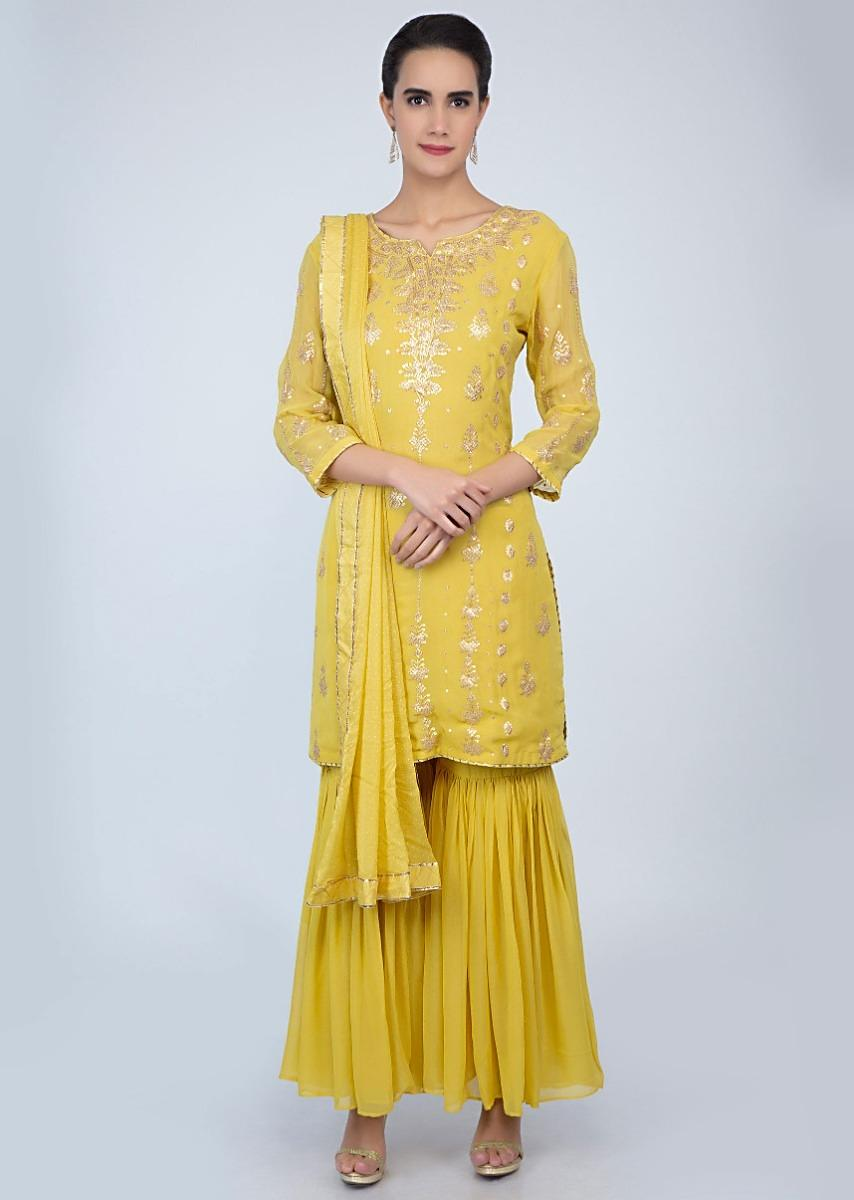 d5bd2cd3f3 Pine yellow georgette sharara suit in zari embroidery and butti only on  Kalki