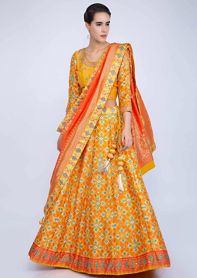 Pine Yellow Lehenga With Patola Print And Contrasting Punch Pink Weaved Dupatta Online - Kalki Fashion