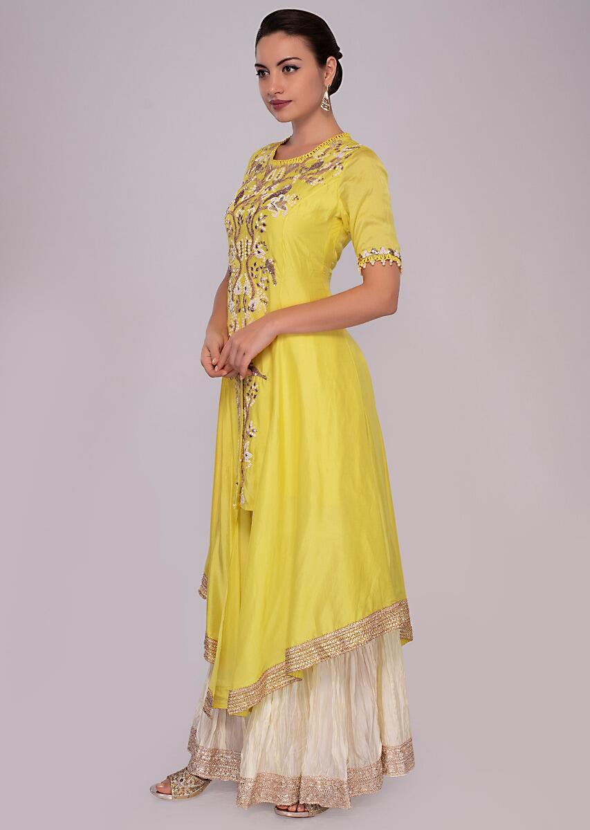 3ebd75f533 Pine yellow suit in front panel embroidery with off white sharara only on  Kalki