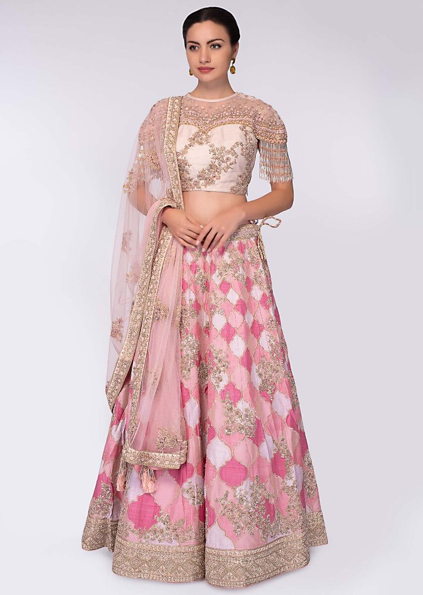 9d656cc7ce Pink and white shade raw silk lehenga paired with light champagne  embroidered net blouse only on Kalki