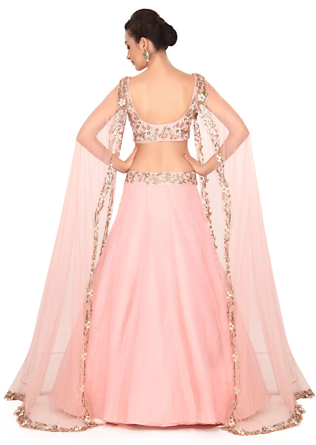 Pink lehenga adorn in pearl and kundan with attached cape only on Kalki