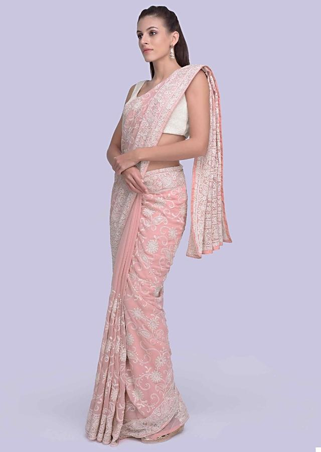 Pink lucknowi embroidered georgette saree in floral, geometric and paisley motif only on Kalki
