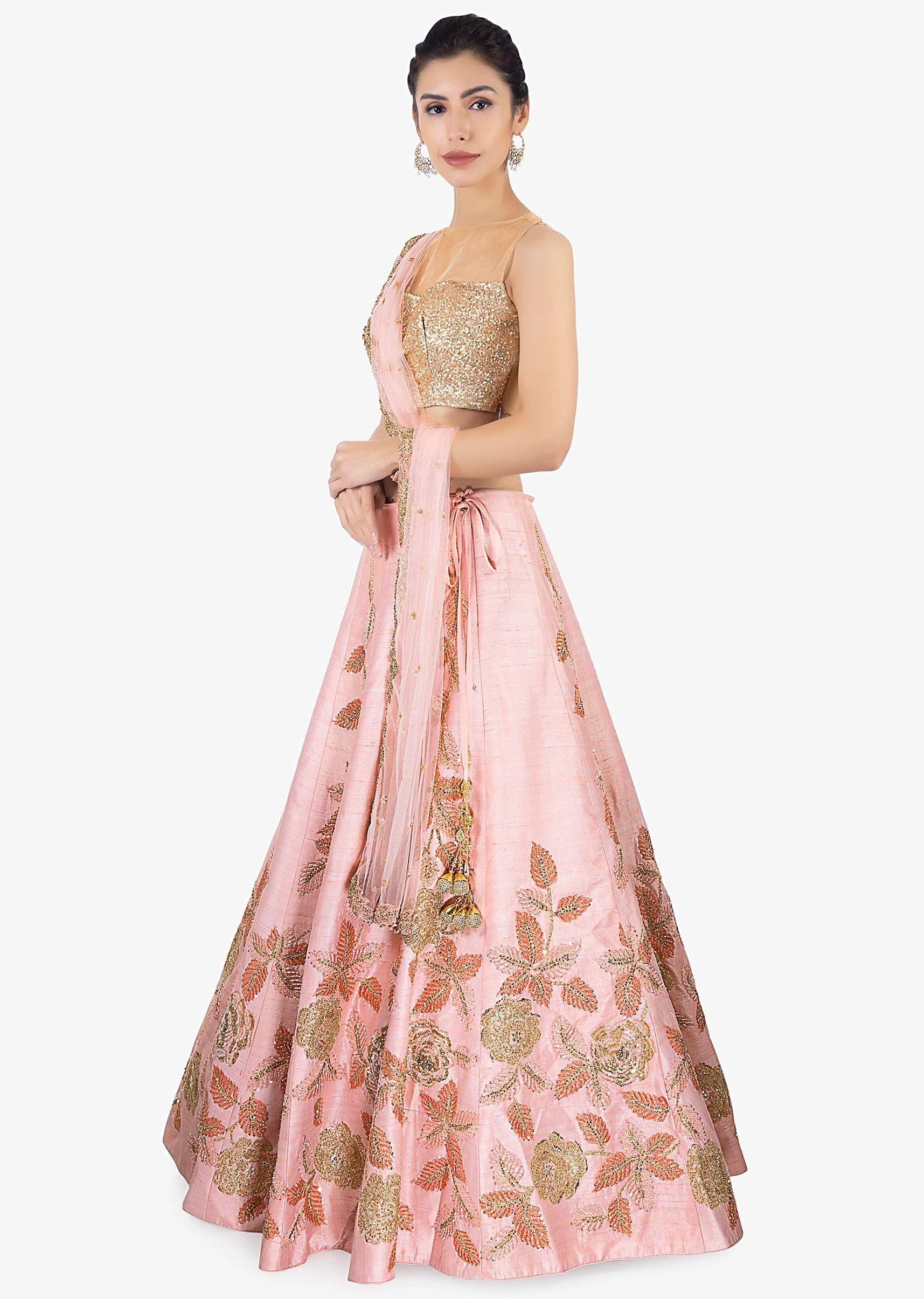 de8aaae166 Pink raw silk lehenga paired with net dupatta and an unstitched embroidered  blouse only on Kalki