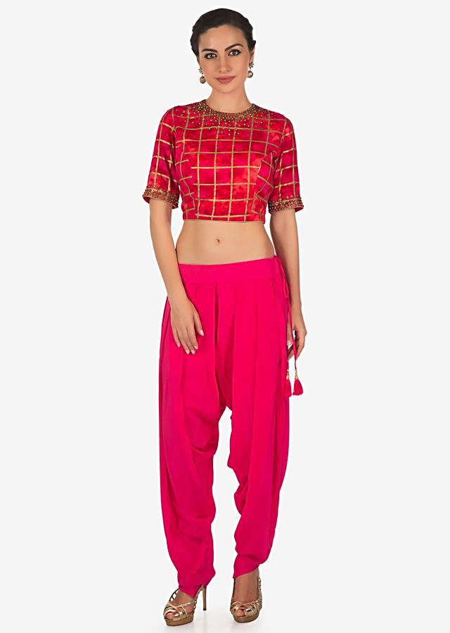 Pink dhoti pants matched with shaded crop top blouse in kundan embroidery only on Kalki