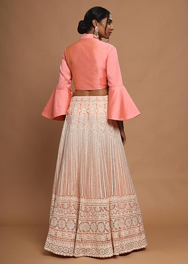 Pinkish Peach Lucknowi Lehenga And Crop Top With Bell Sleeves And Elaborate Collar Online - Kalki Fashion