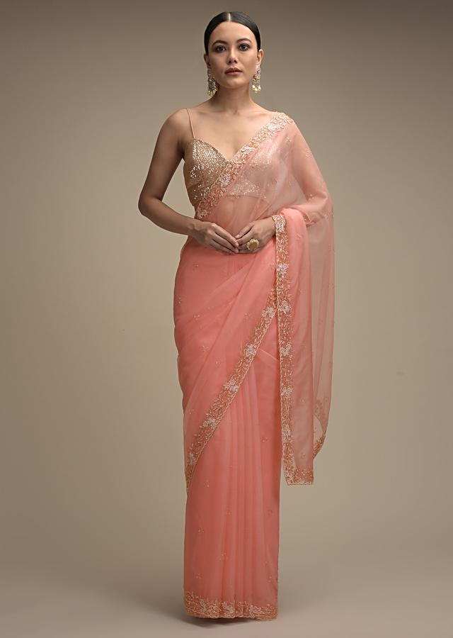 Pinkish Peach Saree In Organza With Hand Embroidered Floral Floral Border And Scattered Buttis Online - Kalki Fashion