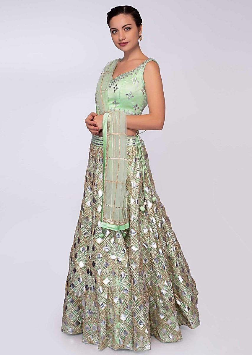 d50be3bc5b Pista green net lehenga with patch work paired with matching blouse and net  dupatta only on KalkiMore Detail