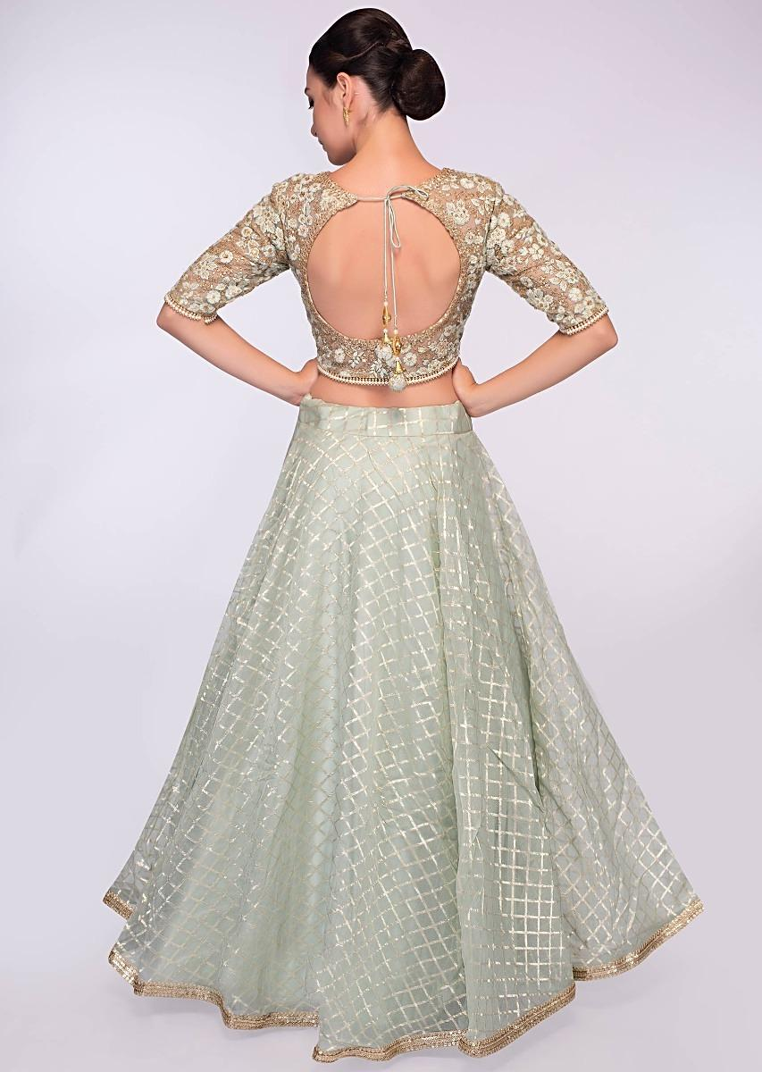 ce2e409dfc52c5 Pista green organza lehenga in checks paired with net blouse in floral  resham embroidery only on Kalki