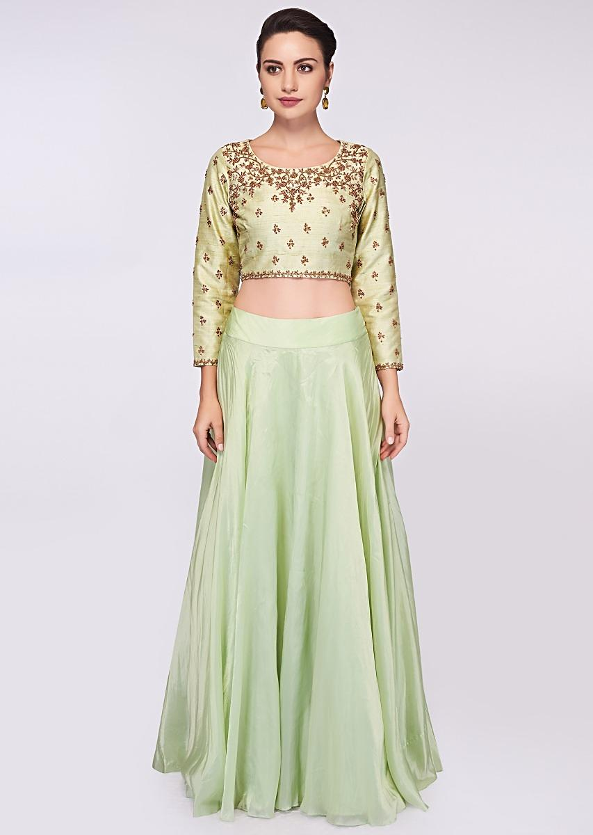 fb4abc51c22fb Pista green raw silk blouse in embroidery and butti paired with matching  organza skirt and wrap around only ...