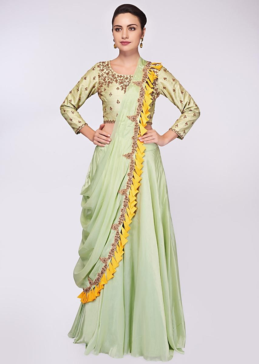 8e15638b760dd Pista green raw silk blouse in embroidery and butti paired with matching  organza skirt and wrap around only on KalkiMore Detail