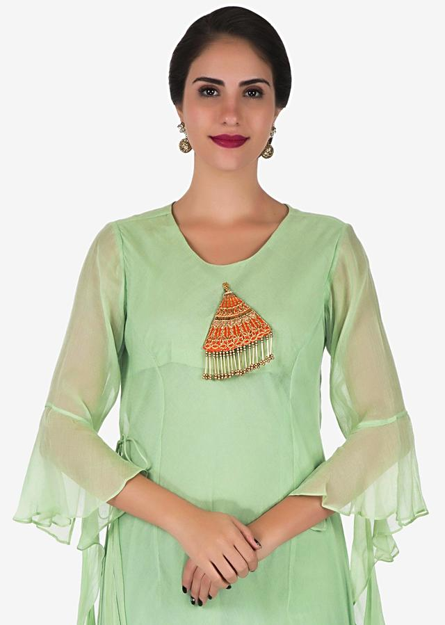 Pista green tunic in cotton with a embroidered tassel at the bodice only on Kalki
