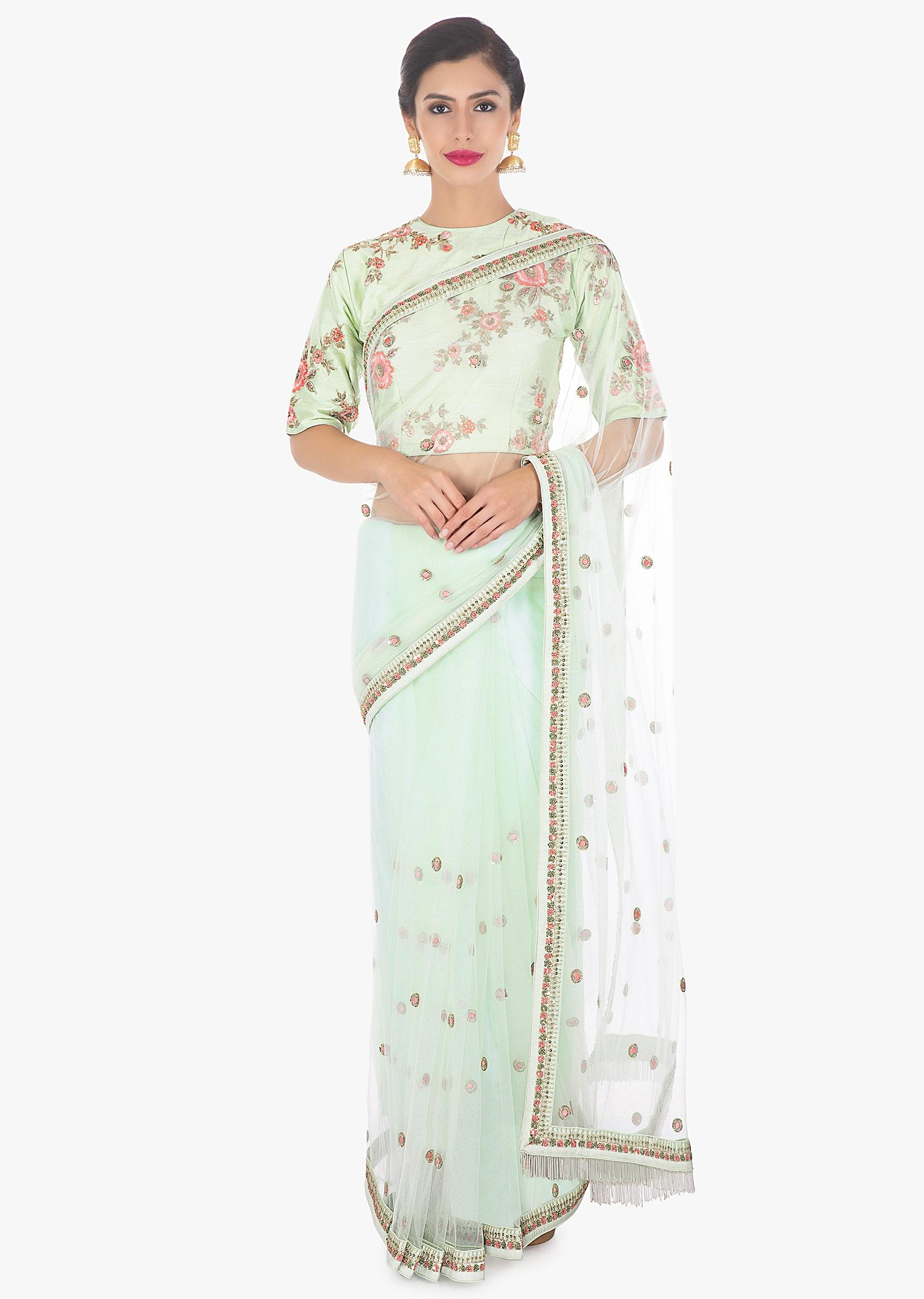 95959bb3191e3 Pistachio net saree paired with a matching raw silk blouse only on Kalki