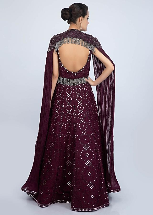 Plum Gown With Cord Embroidery Teamed With Shoulder Cape And Flared Sleeves Online - Kalki Fashion