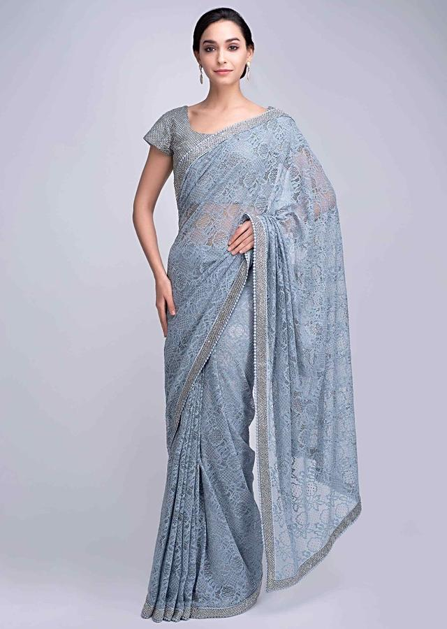 Powder Blue Saree In Chantilly Lace With Heavy Cut Dana And Kundan Embroidered Border Online - Kalki Fashion