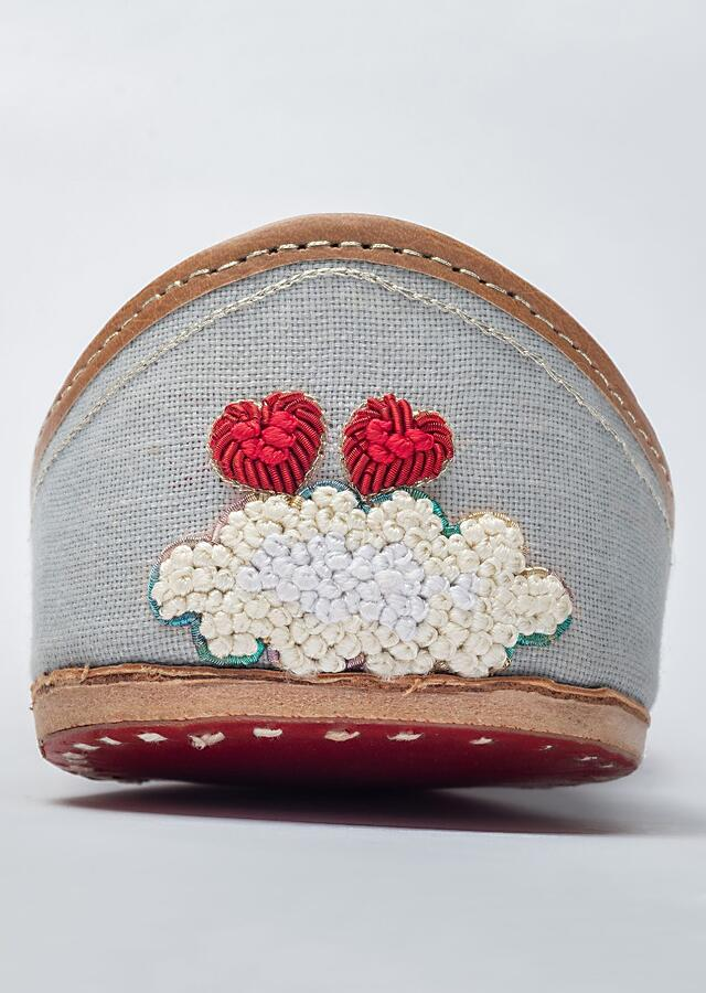 Powder Blue Juttis In Linen With French Knot Clouds Having Zardozi Border And Red Hearts By Vareli Bafna