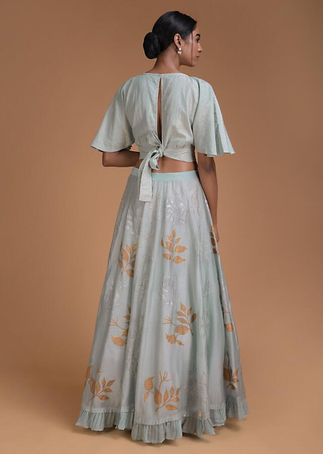Powder Blue Lehenga And Crop Top With Foil Printed Leaf Motifs Online - Kalki Fashion