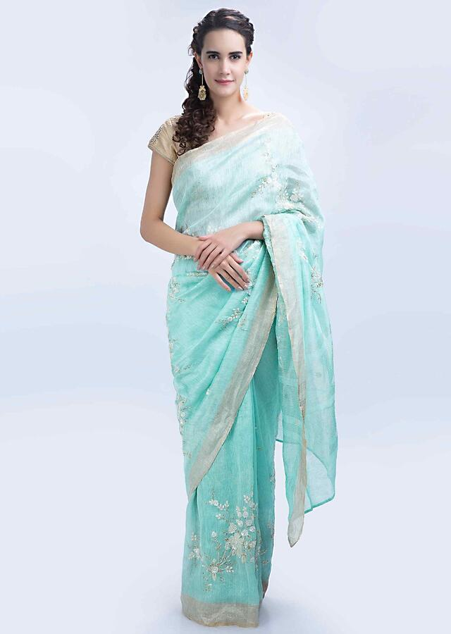 Powder blue linen saree with floral jaal embroidery only on Kalki